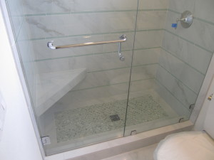 Glass enclosed shower by Envision Design